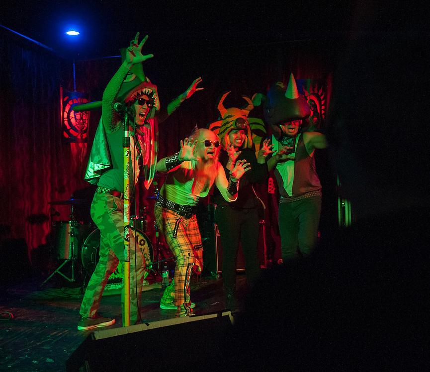 "Akihiko ""Cherry"" Naruse (AKA Peelander Green), left,  Kengo Hioki (AKA Peelander Yellow), a Peelander fan and Akiteru Ito (AKA Peelander Purple) of Peelander-Z performing at Alex's Bar in Long Beach to promote the release of the band's documentary ""Mad Tiger,"" on April 10, 2016 at Alex's Bar in Long Beach, CA."