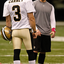 October 3, 2010; New Orleans, LA, USA; New Orleans Saints place kicker Garrett Hartley (left) gets instructions from kicker John Carney (3) during warm ups prior to kickoff of a game between the New Orleans Saints and the Carolina Panthers at the Louisiana Superdome. Mandatory Credit: Derick E. Hingle