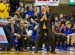 Kansas Jayhawks head coach Bill Self reacts after a play call against the West Virginia Mountaineers during the second half at the WVU Coliseum.