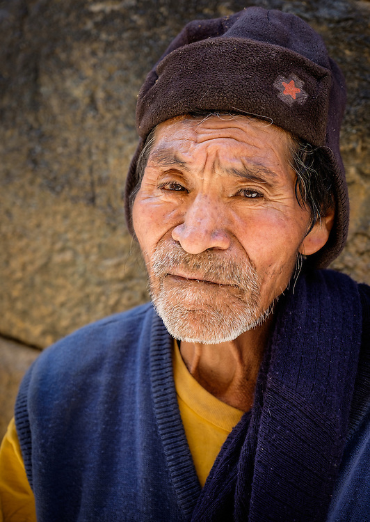 OLLANTAYTAMBO, PERU - CIRCA OCTOBER 2015:  Portrait of local man in the village of Ollantaytambo, a small town in the Cusco region known as Sacred Valley