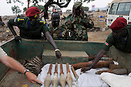 SPLA officers examine some of the huge number of unexploded ordinance found scattered across a large, open terrain just opposite John Garang's tomb in Juba as the area was being prepared for South Sudan independence ceremonies. The Government of South Sudan called on Mines Advisory Group (MAG) to assist SPLA deminers in an attempt to clear the area and make it safe for the thousands of people and dignitaries who will be attending the declaration of independence on July 9th...Juba, South Sudan. 04/07/2011..Photo © J.B. Russell
