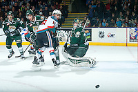 KELOWNA, CANADA - JANUARY 24: Carter Hart #70 of Everett Silvertips deflects a shot by Dillon Dube #19 of Kelowna Rockets on January 24, 2015 at Prospera Place in Kelowna, British Columbia, Canada.  (Photo by Marissa Baecker/Shoot the Breeze)  *** Local Caption *** Carter Hart; Dillon Dube;