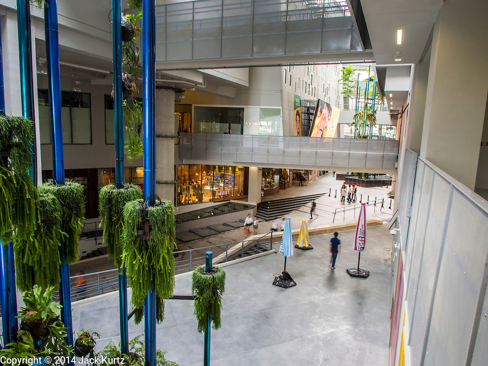 15 JULY 2014 - BANGKOK, THAILAND: The main atrium in Siam Square 1, an expansion of Siam Square, a shopping and entertainment area in Bangkok. There is a range of shops and services, including tutor schools, restaurants, cafe, designer clothing boutiques, record stores, bookshops, Hard Rock Cafe and banks in the area. Siam Square is owned by Chulalongkorn University and is managed by its Property Management Office, known as the Chula Property.    PHOTO BY JACK KURTZ
