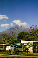 A view of Mt Meru seen from the Kaloleni Primary school in Arusha Tanzania.  Mount Meru is the fifth highest mountain in Africa with its summit reaching 14,990 feet.  It is a popular climb among tourists.