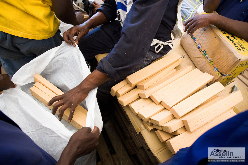 Workers put bars of soap in a UNICEF-sponsored domestic kit to be distributed to displaced populations across eastern DRC at a UNICEF depot in Goma, Eastern Democratic of Congo on Monday December 15, 2008. The kits contain blankets, a mosquito net, fabric, tarp, soap, cookware, floor mats and a jerican.