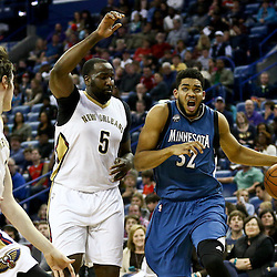 Feb 27, 2016; New Orleans, LA, USA; Minnesota Timberwolves center Karl-Anthony Towns (32) drives past New Orleans Pelicans center Kendrick Perkins (5) during the first half of a game at  the Smoothie King Center. Mandatory Credit: Derick E. Hingle-USA TODAY Sports