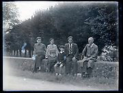 family sitting in an rural outdoors setting France circa 1930s