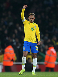 Brazil's Neymar celebrates scoring his side's first goal of the game from the penalty spot during the International Friendly match at the Emirates Stadium, London.