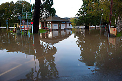 © Licensed to London News Pictures. 26/10/2019. Builth Wells, Powys, Wales, UK. The Groe recreation ground and car park and adjoing A483 road is flooded. Following very heavy rainfall for several days, extremely high river levels of the River Wye and River Irfon, flood parts of the Welsh market town of Builth Wells in Powys, UK. causing damage to property. Photo credit: Graham M. Lawrence/LNP