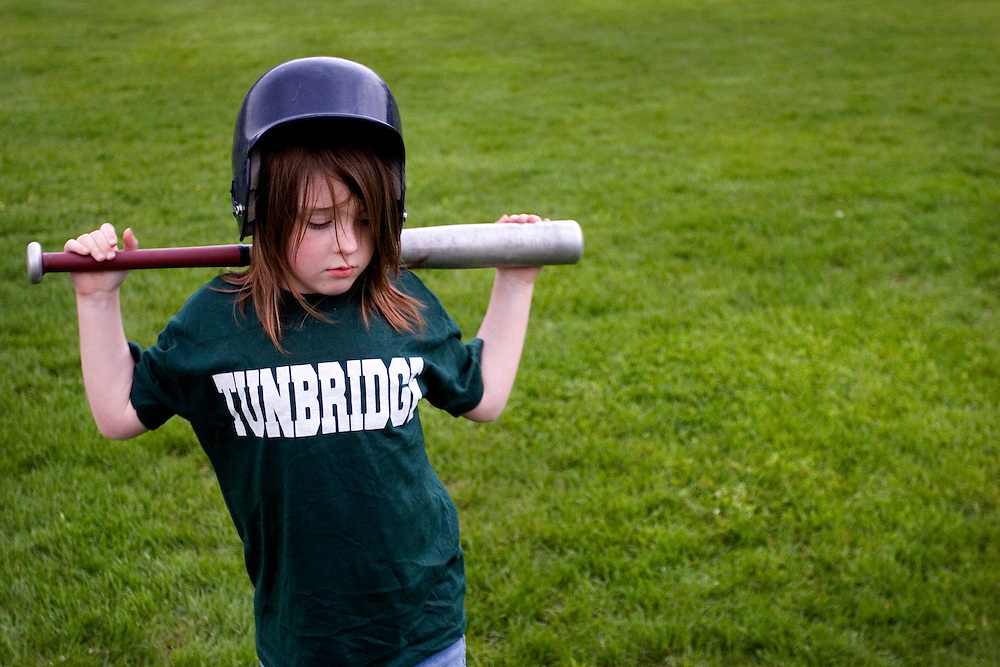 A t-ball player waits her turn for an at-bat during a t-ball game in Tunbridge, Vt., on May 20, 2008. T-ball's origins date to at least the 1940s -- the game has been played on the South Lawn of the White House since the Reagan Administration. (Photo by Geoff Hansen)