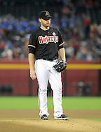 Jul 14, 2013; Phoenix, AZ, USA;  Arizona Diamondbacks pitcher Ian Kennedy (31) stands on the mound in the game against the Milwaukee Brewers at Chase Field. The Brewers defeated the Diamondbacks 5-1. Mandatory Credit: Jennifer Stewart-USA TODAY Sports