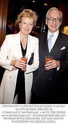 LORD & LADY CHADLINGTON at a party in London on 15th October 2002.			PEC 36