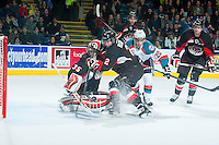 KELOWNA, CANADA - DECEMBER 30: Sam Ruopp #2 of Prince George Cougars deflects the puck away from the goal of Ty Edmonds #35 on December 30, 2014 at Prospera Place in Kelowna, British Columbia, Canada.  (Photo by Marissa Baecker/Shoot the Breeze)  *** Local Caption *** Ty Edmonds; Sam Ruopp;