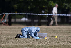 FILE PICTURE © Licensed to London News Pictures. 12/08/2016. London, UK. A scenes of crime officer is seen in Hyde Park after the body of Jairo Medina, a professional carer from Chelsea was found. The trial  of Hani Khalaf, who is charged with his murder, begins today at the Old Bailey. Photo credit: Peter Macdiarmid/LNP