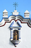 A statue of the Virgin Mary in a niche on the facade of Santa Maria de la Asuncion in Tule, Mexico.