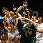 Gabby Williams, UConn, rebounds while challenged by Courtney Williams and Katelyn Weber, (right), USF during the UConn Huskies Vs USF Bulls Basketball Final game at the American Athletic Conference Women's College Basketball Championships 2015 at Mohegan Sun Arena, Uncasville, Connecticut, USA. 9th March 2015. Photo Tim Clayton