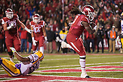 FAYETTEVILLE, AR - NOVEMBER 15:  Alex Collins #3 of the Arkansas Razorbacks runs for a touchdown against the LSU Tigers at Razorback Stadium on November 15, 2014 in Fayetteville, Arkansas.  The Razorbacks defeated the Tigers 17-0.  (Photo by Wesley Hitt/Getty Images) *** Local Caption *** Alex Collins