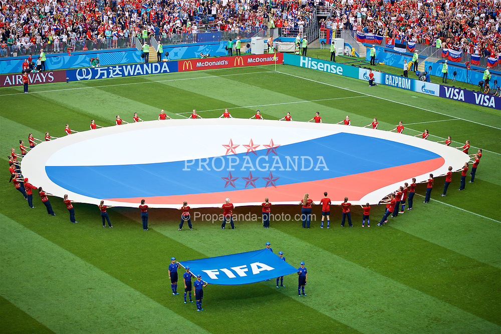 MOSCOW, RUSSIA - Sunday, July 1, 2018: Volunteers unveil a huge Russia flag on the pitch before the FIFA World Cup Russia 2018 Round of 16 match between Spain and Russia at the Luzhniki Stadium. (Pic by David Rawcliffe/Propaganda)