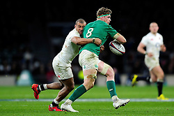 Jonathan Joseph of England tackles Jamie Heaslip of Ireland - Mandatory byline: Patrick Khachfe/JMP - 07966 386802 - 27/02/2016 - RUGBY UNION - Twickenham Stadium - London, England - England v Ireland - RBS Six Nations.