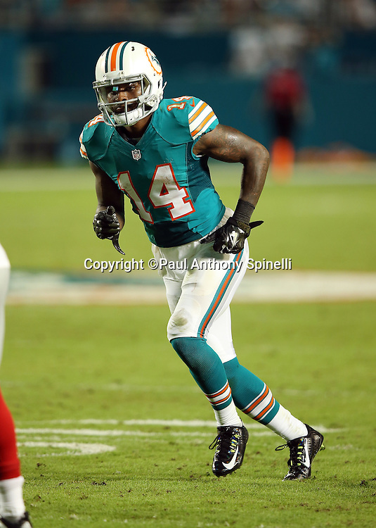 Miami Dolphins wide receiver Jarvis Landry (14) goes out for a pass during the NFL week 14 regular season football game against the New York Giants on Monday, Dec. 14, 2015 in Miami Gardens, Fla. The Giants won the game 31-24. (©Paul Anthony Spinelli)