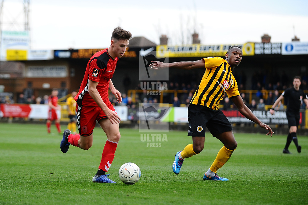 TELFORD COPYRIGHT MIKE SHERIDAN 2/3/2019 - Ryan Barnett of AFC Telford (on loan from Shrewsbury Town Football Club) takes on Jonathan Wufala of Boston during the National League North fixture between Boston United and AFC Telford United at the York Street Jakemans Stadium