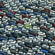 Hundreds of new cars wait in a holding area for new Chrysler automobiles near a railroad yard in Auburn, Wash. on Saturday October 6, 2007 in this aerial photo. As negotiations continued Monday, the United Auto Workers set a deadline of Wednesday morning to agree on a new contract, or elose workers could strike. (AP Photo/Seattle Post-Intelligencer, Joshua Trujillo)