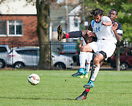 10/31/15 – Medford/Somerville, MA – Tufts midfielder Nathan Majumder, A17, knocks a Bowdoin player backwards after Majumder failed to block him from kicking in the game against the Bowdoin Polar Bears on Saturday, Oct. 31, 2015. (Evan Sayles / The Tufts Daily)