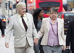 © Licensed to London News Pictures. 27/11/2013. London, UK. Owners of the Chymorvah Hotel in Marazion, Cornwall, Hazelmary and Peter Bull, arrive at the Supreme Court to hear judgement on their case in London today (27/11/2013). The couple found out today that they failed in their bid to have a previous judgement, ordering them to pay damages to a gay couple who were told that they could not share a double bed at the bed and breakfast, overturned.