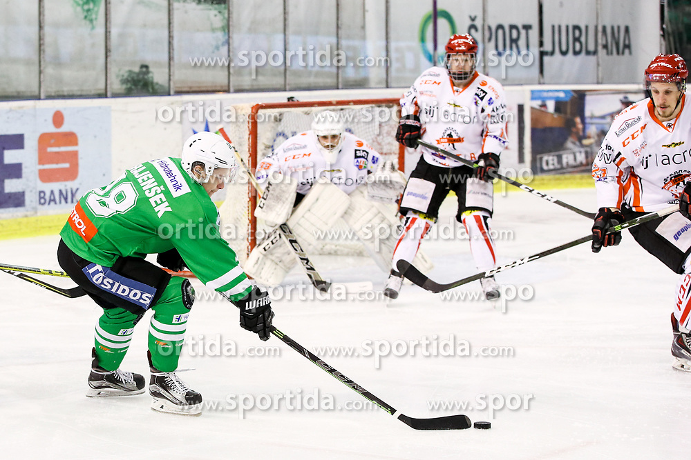 Tim Ograjensek of Olimpija and Zan Us of Jesenice during ice hockey match between HDD Olimpija Ljubljana and HDD SIJ Acroni Jesenice in Final of Slovenian League 2016/17, on April 12, 2017 in Hala Tivoli, Ljubljana, Slovenia. Photo by Matic Klansek Velej / Sportida