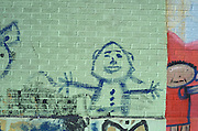 child's drawing on a brick wall