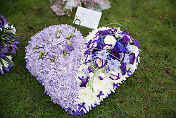 © Licensed to London News Pictures. 18/01/2015. Measham, Leicestershire, UK. The scene outside St Laurence's Church in the centre of Measham for the service of Kayleigh Haywood. Pictured, tributes laid outside the church. Photo credit : Dave Warren/LNP