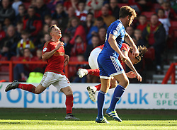 Harlee Dean of Brentford appears to elbow Henri Lansbury of Nottingham Forest (R)  - Mandatory by-line: Jack Phillips/JMP - 02/04/2016 - FOOTBALL - City Ground - Nottingham, England - Nottingham Forest v Brentford - Sky Bet Championship
