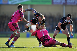 Damian Welch of Exeter Chiefs is tackled by Nathan Trevett of London Welsh - Photo mandatory by-line: Patrick Khachfe/JMP - Mobile: 07966 386802 07/03/2015 - SPORT - RUGBY UNION - Exeter - Sandy Park - Exeter Chiefs v London Welsh - Aviva Premiership