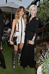 Left to right, WHINNIE WILLIAMS and PORTIA FREEMAN at the Warner Music Group & GQ Summer Drinks hosted in asociation with Quintessentially at Shoreditch House, Ebor Street, London on 6th July 2016.