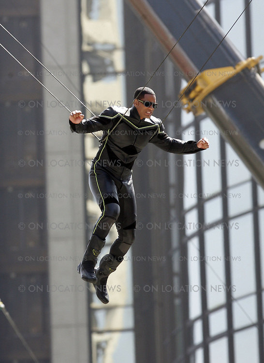OS ANGELES, CALIFORNIA - Sunday July 22nd 2007. NON EXCLUSIVE: Will Smith on the set of his latest movie ' Hancock'. In this scene Smith is suspended 14 storys high on cables & swings in to land on a freeway bridge. He plays plays a hard-living superhero who has fallen out of favor with the public, enters into a questionable relationship with the wife (Charlize Theron) of the public relations professional (Jason Bateman) who's trying to repair his image. Photograph: David Buchan/Eric Ford. Sales: Eric Ford 1/818-613-3955 info@onlocationnews.com
