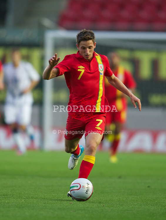 LLANELLI, WALES - Wednesday, August 15, 2012: Wales' Joe Allen in action against Bosnia-Herzegovina during the international friendly match at Parc y Scarlets. (Pic by David Rawcliffe/Propaganda)