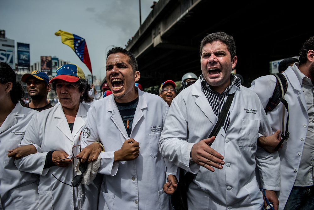 CARACAS, VENEZUELA - MAY 22, 2017: Thousands of doctors, patients and other healthcare professionals march in a peaceful protest organized to show discontent with widespread medicine shortages and the public healthcare system that has been crippled by the economic crisis.  Over 85 percent of medicines are either impossible, or very difficult to find in Venezuela. Hospitals rarely have even the most basic supplies, like gauze, latex gloves, syringes, antibiotics or even running water.  PHOTO: Meridith Kohut