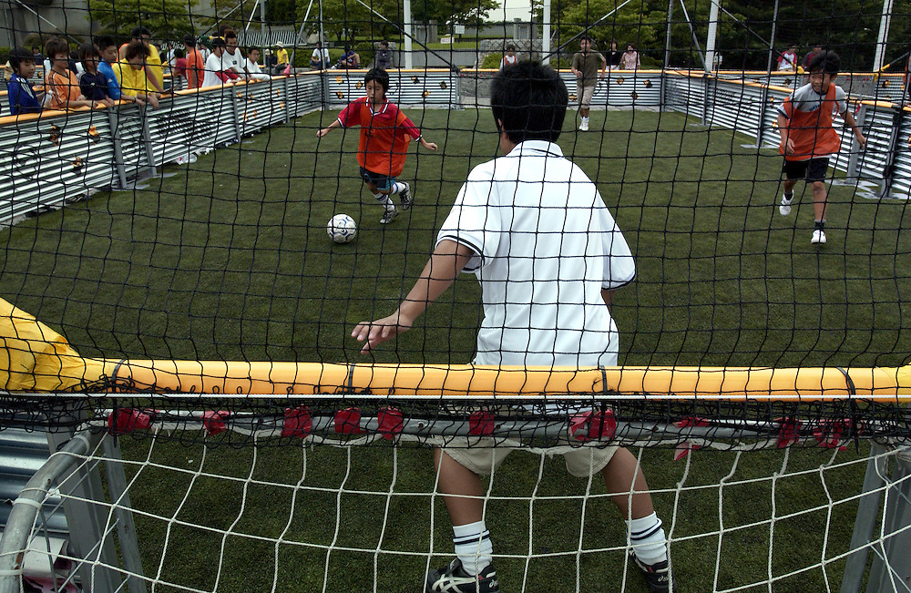 Future soccer stars play three on three knockout matches at NikePark in Harajuko, Tokyo 24/06/02..©David Dare Parker/AsiaWorks Photography
