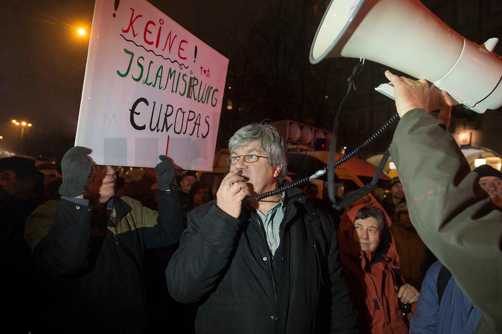 """05 JAN 2015, BERLIN/GERMANY:<br /> Dr. Karl Schmitt (M), vom Verein """"Patrioten"""", Anmelder der Bärgida-Demo """"Berliner Patrioten gegen die Islamisierung des Abendlandes"""", haelt mit Hilfe eines Megafons eine Rede, Baergida Demo, Spandauer Strasse<br /> IMAGE: 20150105-01-054<br /> KEYWORDS: Bärgida, Demonstranten, Protest, Demonstration,"""