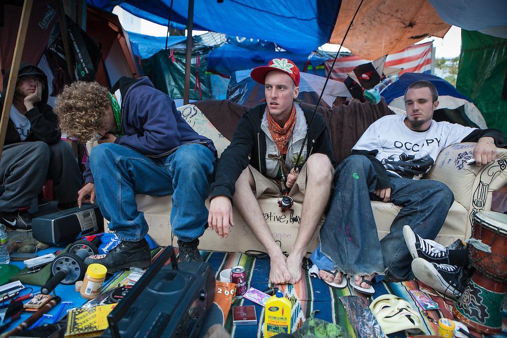 November 14th, San Francisco California,  Michael Williams, Ryan Hadar and Gary Baumann man a trading post at Occupy San Francisco in Justin Herman Plaza.  Occupy San Francisco was set up in solidarity with Occupy Wall Street.