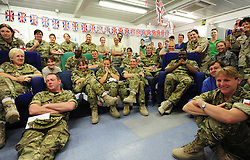 Camp Bastion, Afghanistan  29/04/2011. The Royal Wedding of HRH Prince William to Kate Middleton. Staff from the military hospital in Camp Bastion spend their lunch break watching some of the Royal Wedding today.  Photo credit should read Alison Baskerville/LNP. Please see special instructions. © under license to London News Pictures