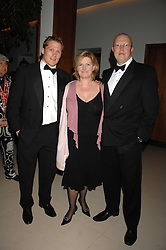 Left to right, Rugby international JOSH LEWSY and PADDY & LOUISE ROGERS at The Monopoly Dinner as part of the Simon Shaw benefit year in support of the NSPCC and Sparks held at The Hurlingham Club, London on 21st March 2007.<br />