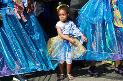 © Licensed to London News Pictures. 27/08/2017. London, UK. A young girl carnival dancer parades on the first day of Notting Hill Carnival in west London. It is second largest street festival in the world after the Rio Carnival in Brazil, attracting over 1 million people. Photo credit: Ray Tang/LNP