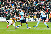 Graham Carey (10) of Plymouth Argyle shoots at goal during the EFL Sky Bet League 1 match between Plymouth Argyle and Accrington Stanley at Home Park, Plymouth, England on 22 December 2018.