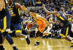 Feb 10, 2018; Morgantown, WV, USA; Oklahoma State Cowboys guard Jeffrey Carroll (30) dribbles during the first half against the West Virginia Mountaineers at WVU Coliseum. Mandatory Credit: Ben Queen-USA TODAY Sports