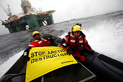 GREENLAND DAVIS STRAIT 17JUN11 -– The International Executive Director of Greenpeace, Kumi Naidoo, has entered an exclusion zone to scale a controversial Arctic oil rig 120km off the coast of Greenland...At 5am this morning an inflatable speedboat carrying Naidoo was launched from the Greenpeace ship Esperanza. It evaded a Danish navy warship that has been circling the rig for several weeks then he climbed a 30 metre ladder up the outside of one of the platform's giant legs...His action comes a week after the operators of the oil platform, Cairn Energy, obtained an injunction against Greenpeace from a Dutch court, imposing fines of 50,000 Euros a day for any breach of the exclusion zone...Photo by Jiri Rezac / Greenpeace