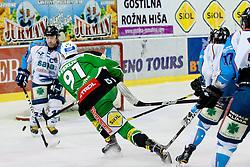 Miha Verlic (HDD Tilia Olimpija, #91) misses empty net during ice-hockey match between HDD Tilia Olimpija and SAPA Fehervar AV19 at sixth match in Quarterfinal  of EBEL league, on March 1, 2012 at Hala Tivoli, Ljubljana, Slovenia. HDD Tilia Olimpija won 4:3 and advanced to semifinal. (Photo By Matic Klansek Velej / Sportida)