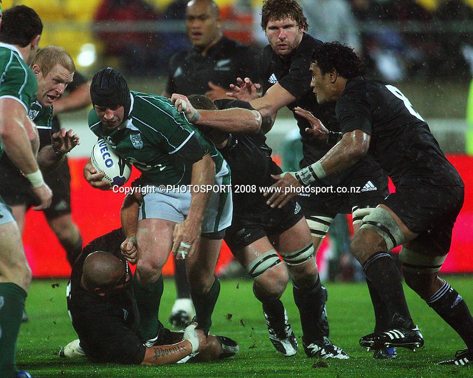 John Schwalger tackles Denis Leamy as Adam Thomson and Jerome Kaino close in.<br /> International Test Match - All Blacks v Ireland, Westpac Stadium, Wellington. Saturday 7 June 2008. Photo: Dave Lintott/PHOTOSPORT