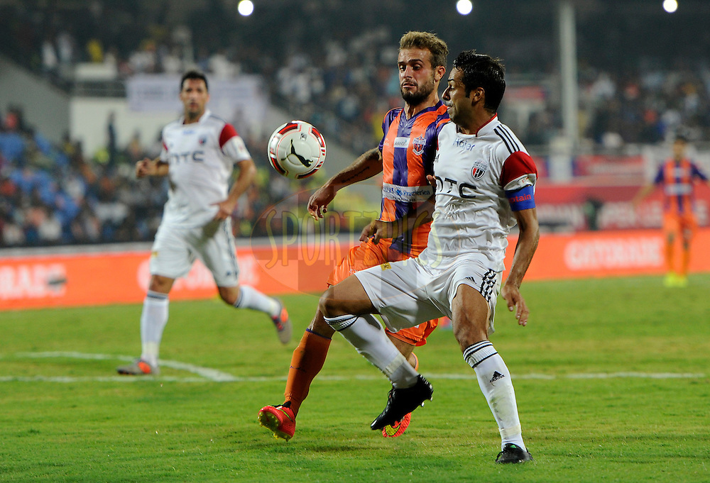 Davide Colomba of FC Pune City and NorthEast United FC captain Miguel Garcia during match 20 of the Hero Indian Super League between FC Pune City and NorthEast United FC held at the Shree Shiv Chhatrapati Sports Complex Stadium, Pune, India on the 3rd November 2014.<br /> <br /> Photo by:  Pal Pillai/ ISL/ SPORTZPICS