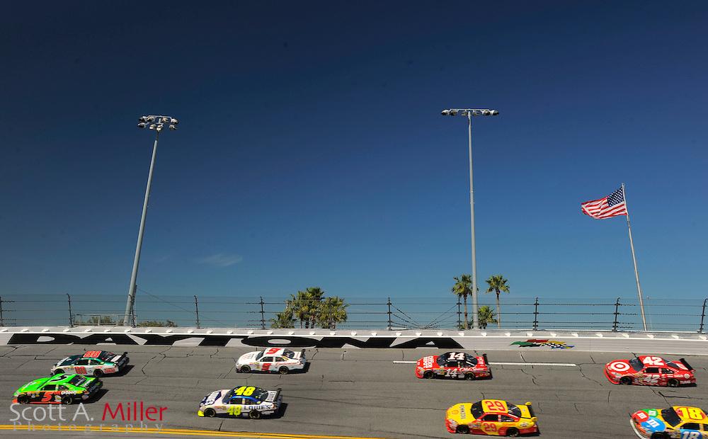 Feb. 14, 2010; Daytona Beach, FL, USA; NASCAR Sprint Cup Series drivers make their way through Turn 4 during the Daytona 500 at Daytona International Speedway. ©2010 Scott A. Miller